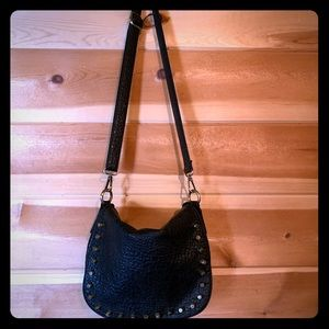 Black purse with bronze colored studs